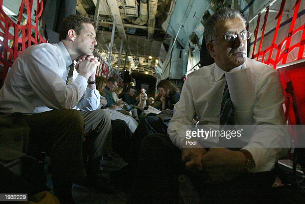 Zalmy Khalilzad White House special envoy to Iraq and Larry Dirita US Secretary of Defense Chief of Staff sit aboard a C130 aircraft 15 April 2003 as...