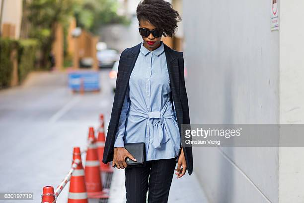 Zama is wearing Zara sleeveless blazer and cropped pants a blue Zara button shirt with knot Zara loafers shoes Aldo shades on December 17 2016 in...