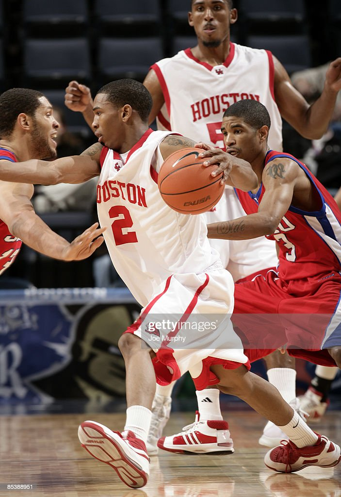 Zamal Nixon #2 of the Houston Cougars drives against Derek Williams #3 of the SMU Mustangs during Round One of the Conference USA Basketball Tournament at FedExForum on March 11, 2009 in Memphis, Tennessee.