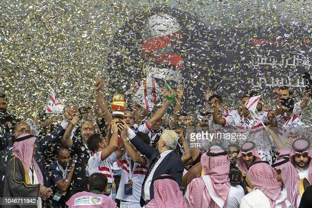 Zamalek players celebrate after winning the first leg of the Saudi and Egypt super match between Saudi's Al Hilal and Egypt's Zamalek at the King...