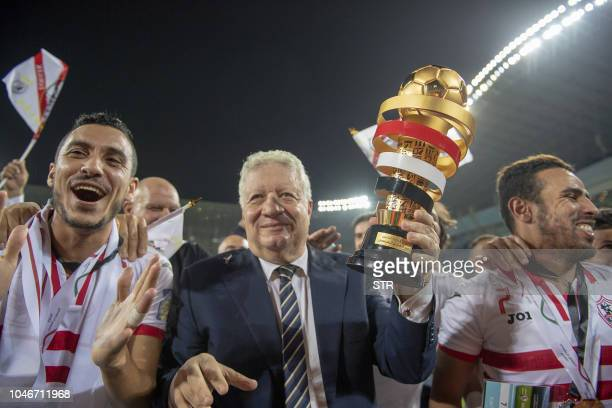Zamalek President Murtada Mansour and players celebrate after winning the first leg of the Saudi and Egypt super match between Saudi's Al Hilal and...
