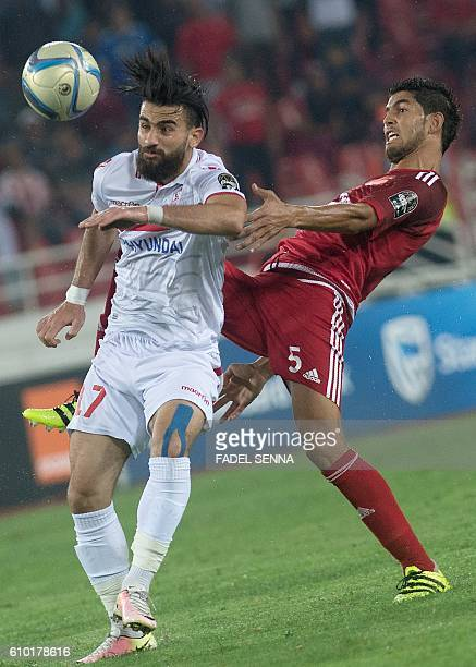 Zamalek Sporting Club's Hazem Mohammed Abdehamid Emam vies with the Wydad Athletic Club's Amine Atouchi during the CAF Champions League semifinal...