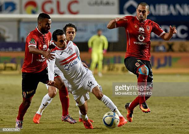 Zamalek's Ayman Hefni vies for the ball against alAhly's Ahmed Fathy and Hossam Ashour during their Egyptian Premier League football match at the...