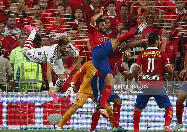 Zamalek's Basem Morsey vies with AlAhly's Hosam Ghaly and Walid Soliman during the Egypt super cup football match between AlAhly SC and Zamalek...
