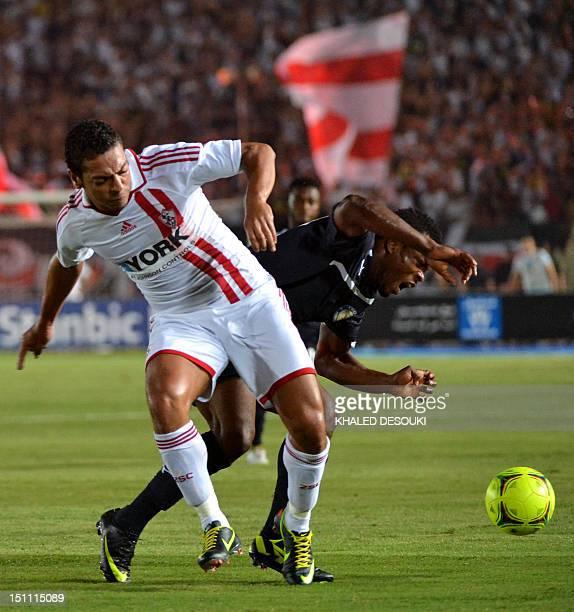 Zamalek's Hani Said challenges Berekum Chelsea's Bismark Idan during their CAF Champions League group B football match in Cairo on September 1 2012...