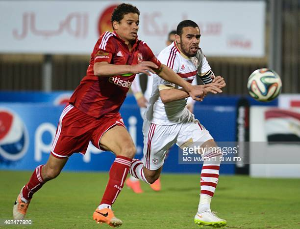 Zamalek's Hazem Emam vies for the ball against AlAhly's Saad Samir during their Egyptian Premier League football match at the 30 June Air Defence...