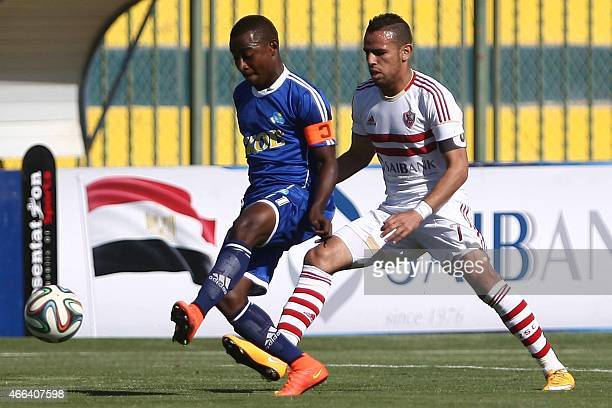 Zamalek's Hazem Emam vies with a Rayon Sports' player during their Group A CAF Champions League football match Egypt's Zamalek versus Rwanda's Rayon...