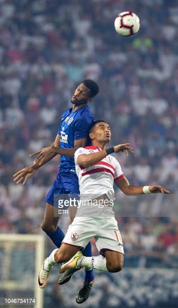 Zamalek's Mahmoud Abdelmuniem vies for the ball with Saudi Al Hilal's Mohammed Alburayek during the first leg of the Saudi and Egypt super match...