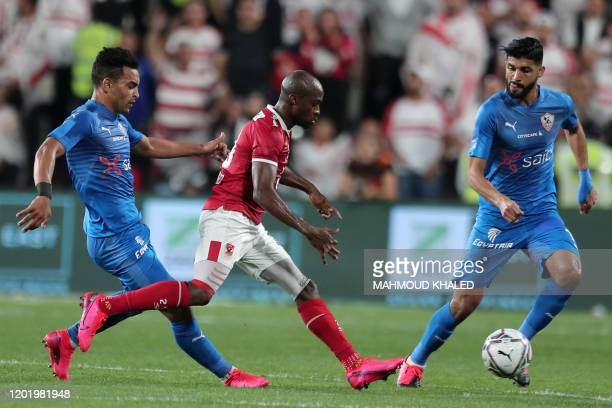 Zamalek's midfielders Youssef Obama and Ferjani Sassi vie for the ball against Ahly's forward Geraldo during the Egyptian Super Cup final football...
