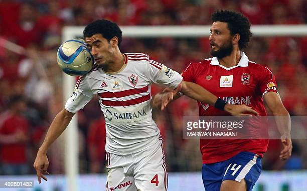 Zamalek's Omar Gaber vies with AlAhly's Hossam Ghaly during the Egypt super cup football match between AlAhly SC and Zamalek Egyptian football clubs...