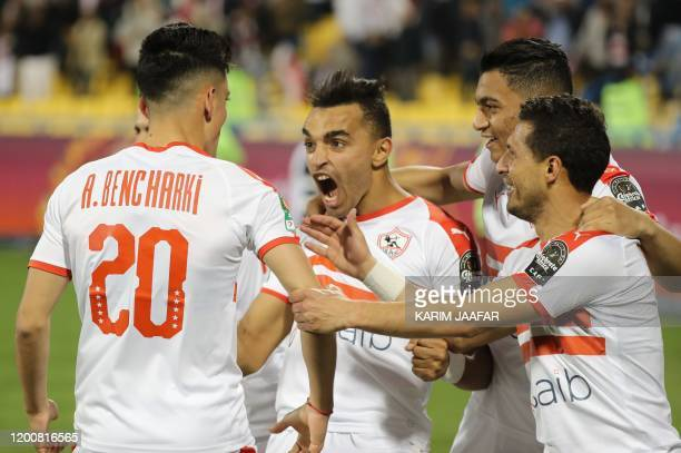 Zamalek's player Achraf Bencharki celebrates his goal with teammates during the CAF Super Cup football match between Tunisia's Esperance and Egypt's...