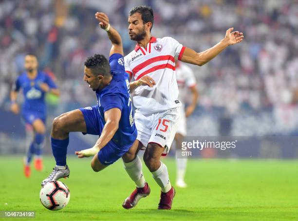 Zamalek's player Bahaa Younes vies for the ball with Saudi Al Hilal's Salem Aldawsari during the first leg of the Saudi and Egypt super match between...
