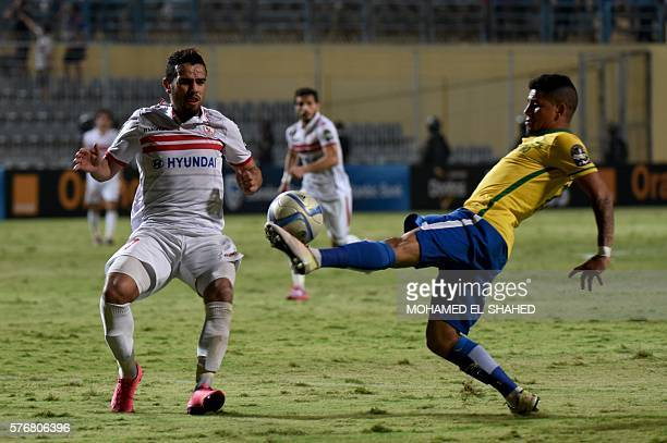 Zamalek's player Hazem Emam views for the ball Sundowns player Keagan Dolly during the African Champions League group stage football match between...