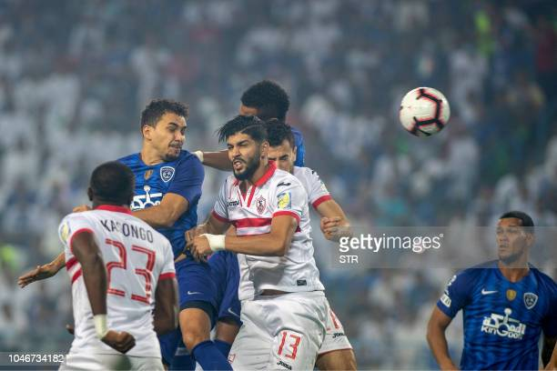 Zamalek's players vie for the ball with Saudi Al Hilal's during the first leg of the Saudi and Egypt super match between Saudi's Al Hilal and Egypt's...
