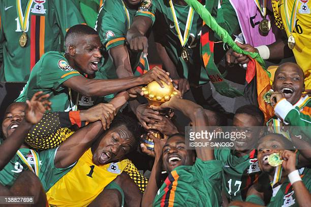 Zambia national football team players celebrate their victory with their trophy at the end of the African Cup of Nations final football match between...