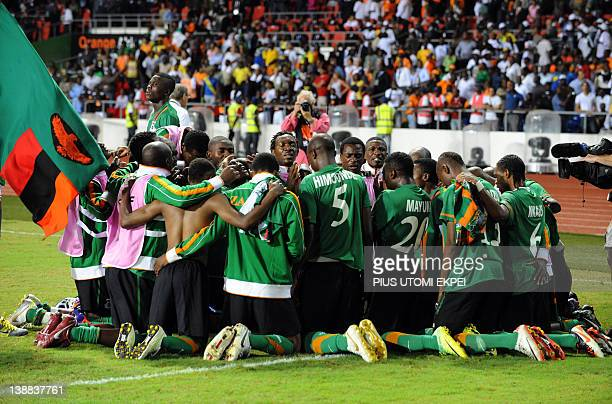 Zambia national team prays together after their victory over Ivory Coast at the Africa Cup of Nations final football between the two teams at stade...
