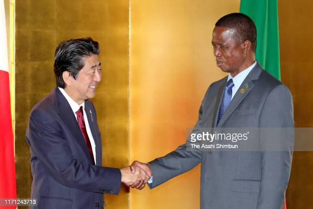 Zambia President Edgar Lungu and Japanese Prime Minister Shinzo Abe shake hands prior to their bilateral meeting on the sidelines of the Seventh...
