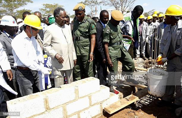 Zambia President Michael Sata lays the foundation stone for the Palabana University on May 17 2013 in Chongwe 60 kms east of Lusaka Sata ordered...