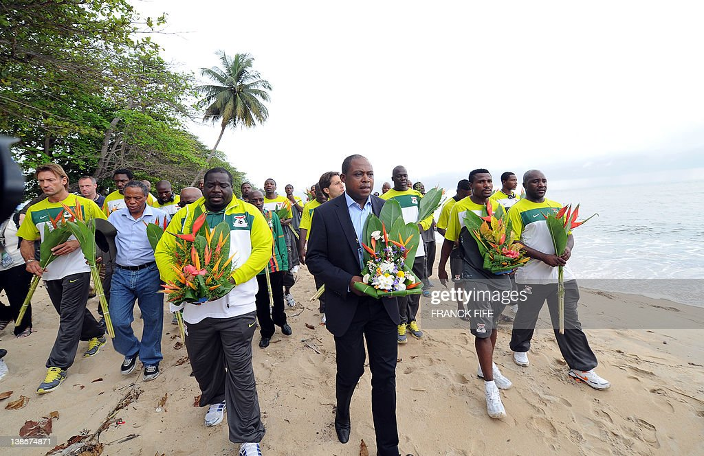 Zambia Sports Minister Chisimba Kambwili (C, L) and the sole survivor of the April 27, 1993 plane crash Year Kalusha Bwalya (C, R), flanked by players of the current Zambia National team pay a tribute to the victims of the crash that wiped out the national team on the beach of Libreville on February 9, 2012. All 30 people, 25 passengers and five crew, on board died. Only former African Footballer of the Year Kalusha Bwalya avoided one of the great African football tragedies because he was based in the Netherlands with PSV Eindhoven and travelled directly to Dakar from Europe. Zambia will play Ivory Coast in the final of the 2012 Africa Cup of Nations on February 12 in Libreville.