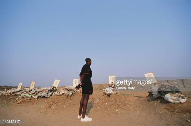 Zambia team captain Kalusha Bwalya pays his respects to the graves of the Zambian national football team members killed in an air crash on 12th July...