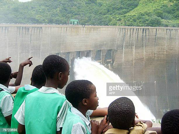 Zambian children witness the opening of the Spill gates on February 12 2008 at Kariba Dam in Zambia The Kariba Dam has been opened by Zimbabwean and...