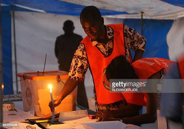 Zambian electoral commission workers start counting the votes in polling station in Buyuni about 30 km east of Lusaka on October 30 2008 in Zambia's...
