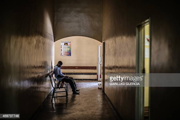 A Zambian man waits on November 28 2014 in the HIV Voluntary Testing and Counseling ward of a Zambian health center in Lusaka The World Health...