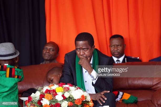 Zambian President Edgar Chagwa Lungu looks on as thousands of Zambians rally to pray against the depreciation of the countrys currency and economic...