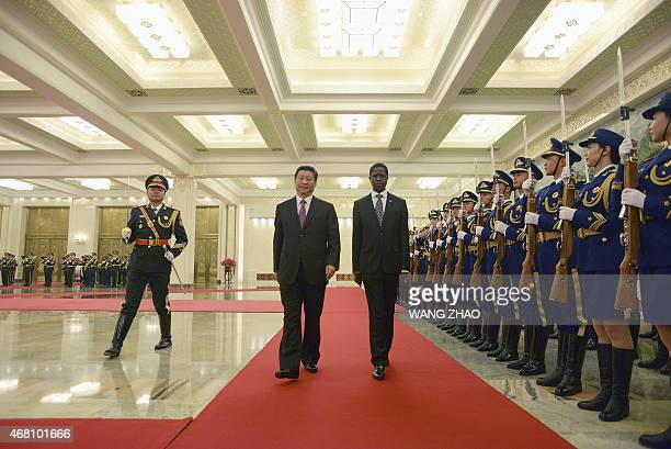 Zambian President Edgar Lungu and Chinese President Xi Jinping inspect Chinese honour guards during a welcome ceremony at the Great Hall of the...