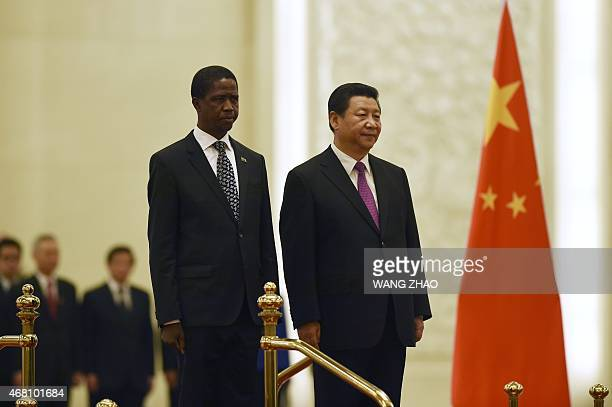 Zambian President Edgar Lungu and Chinese President Xi Jinping prepare to inspect Chinese honour guards during a welcome ceremony at the Great Hall...
