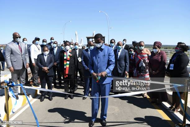 Zambian President Edgar Lungu cuts a ribbon to mark the official opening of the Botswana side of the Kazungula bridge in Kazungula, Botswana on May...