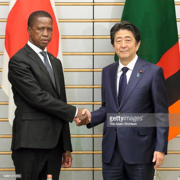 Zambian President Edgar Lungu Japanese Prime Minister Shinzo Abe shake hands prior to their meeting at the prime minister's official residence on...