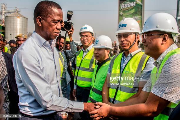 Zambian President Edgar Lungu meets and greets Chinese workers from Aviation Industry Corporation of China during a walk on September 15 2018 on a...