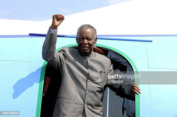 Zambian President Michael Sata gestures upon arrival at Solwezi airport before addressing supporters at an election campaign meeting on September 10...