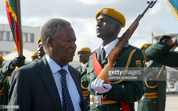 Zambian President Michael Sata inspects the guard of honor in Harare on April 25 2012 Sata is on a on a two day state visit to Zimbabwe AFP/PHOTO...