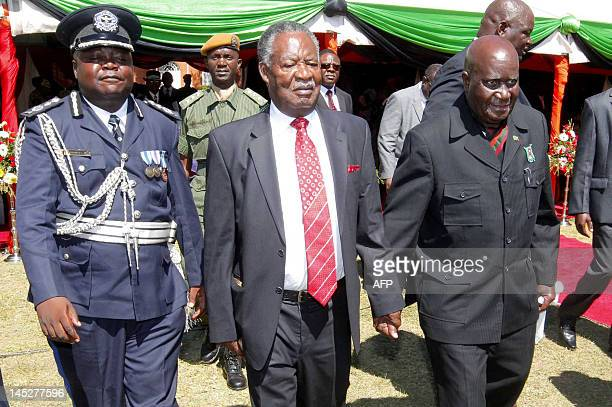 Zambian President Michael Sata walks with the country's first republican President Dr Kenneth Kaunda at State House on Africa Freedom Day after the...