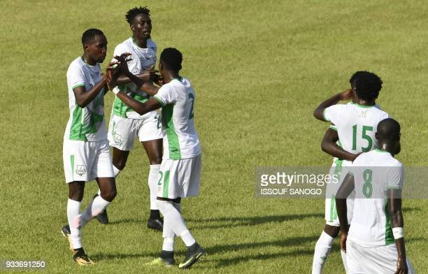 Zambian Zesco United players celebrate after scoring during the Confederation of African Football Champions League match between Asec d'Abidjan and...
