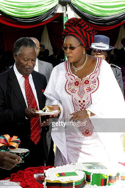 Zambia's First Lady Dr Christine Kaseba saves President Michael Sata a piece of the National Cake on Friday's Africa Freedom Day after the Head of...