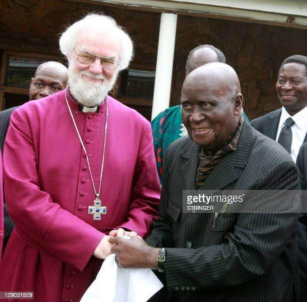 Zambia's former President DrKenneth Kaunda poses with Rowan Williams Archbishop of Canterbury at State House in Lusaka on October 11 2011 after a...