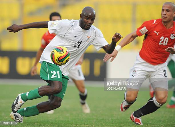 Zambia's James Chamanga controls a ball guarded by Egypt's Wael Gomaa during the group C match between Egypt and Zambia 30 January during the African...