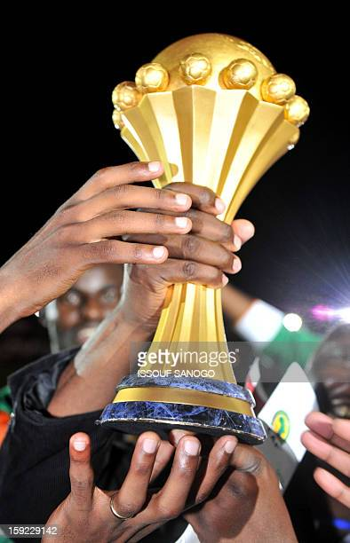 Zambia's national football team players celebrate with the trophy after their victory against Ivory Coast at the stade de l'amitie in Libreville on...