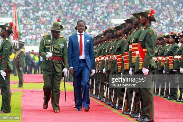 Zambia's newly elected President Edgar Lungu reviews a guard of honour after being sworn in on January 25 2015 at the Heroes National Stadium in...