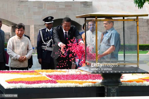Zambia's President Edgar Chagwa Lungu pours rose petals to pay tribute at Rajghat the memorial for Mahatama Gandhi in New Delhi on August 21 2019
