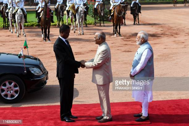 Zambia's President Edgar Chagwa Lungu shakes hands with his Indian counterpart Ram Nath Kovind as India's Prime Minister Narendra Modi looks on...