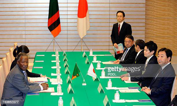 Zambia's President Michael Sata and Japanese Prime Minister Yoshihiko Noda sit at a table prior to the start of their meeting at the premier's...