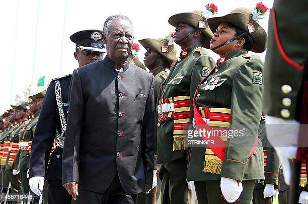 Zambia's President Michael Sata reviews a guard of honour outside the National Assembly building before officially opening the Zambian Parliament on...
