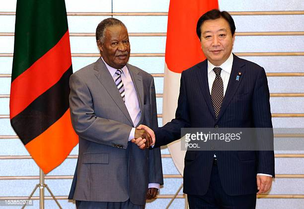 Zambia's President Michael Sata shakes hands with Japanese Prime Minister Yoshihiko Noda prior to their meeting at the premier's official residence...