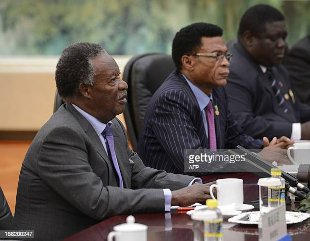 Zambia's President Michael Sata talks with Chinese Premier Li Keqiang during a meeting at the Great Hall of the People in Beijing on April 10 2013...