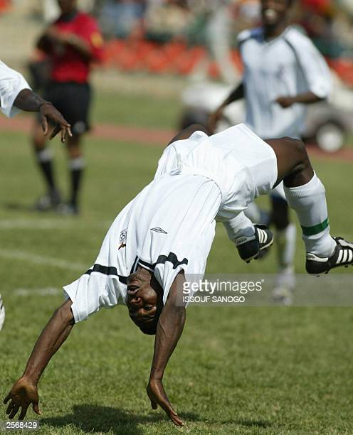 Zambia's striker Chris Katongo jubilates after scoring a goal for his team during their African Games soccer match vs Senegal 07 October 2003 in...