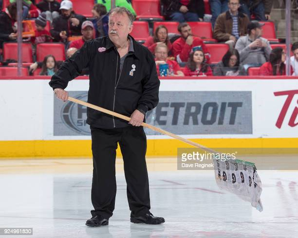 Zamboni driver Al Sobotka mops up a wet area of ice during a before the start of the second period of an NHL game between the Detroit Red Wings and...